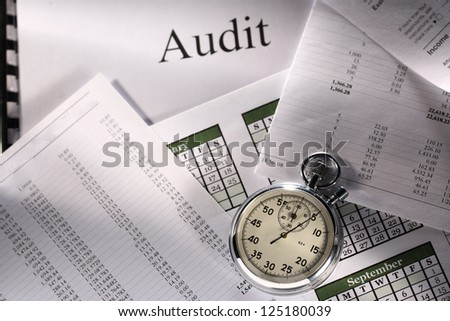 Operating budget, calendar, stopwatch and audit - stock photo