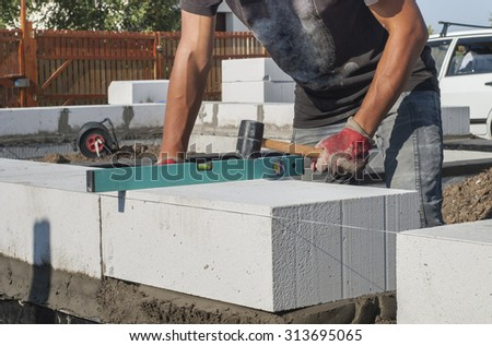 operating levels in the plane of aerated concrete block - stock photo