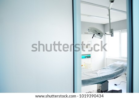 operating room and surgical l& in a modern clinic through an open door & Operating Room Surgical Lamp Modern Clinic Stock Photo (100% Legal ...