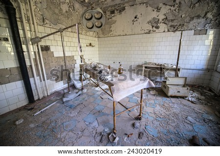 operating room in No. 126 hospital in Pripyat ghost town, Chernobyl Nuclear Power Plant Zone of Alienation, Ukraine - stock photo