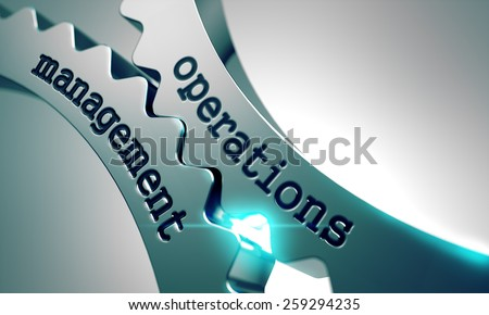 Operations Management on the Mechanism of Metal Gears. - stock photo