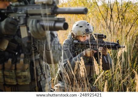 operator Aiming Rifle - stock photo