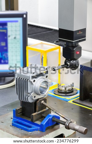 operator inspection dimension by CMM after machining - stock photo