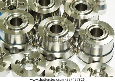 operator inspection dimension of high precision cnc turning parts - stock photo