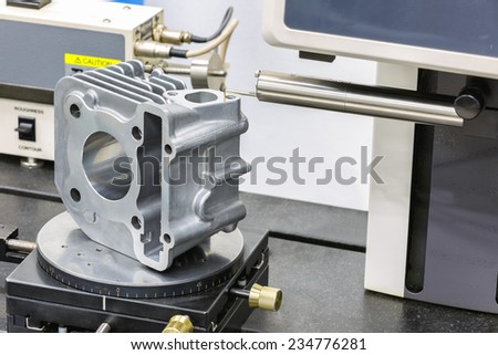 operator inspection roughness on surface after machining - stock photo