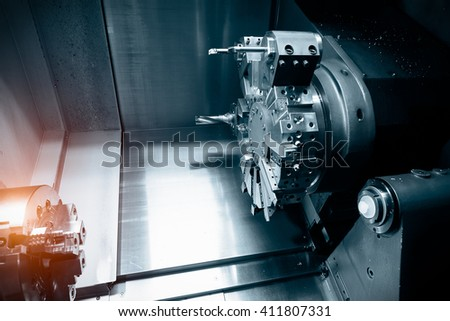 Operator machining automotive part by cnc turning machine - stock photo