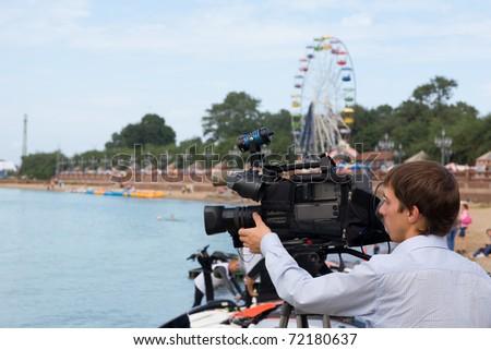 Operator of a television camera for work. Vladivostok. Russia. - stock photo