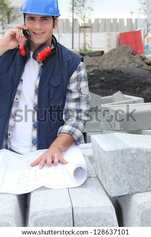 Operator on site with map - stock photo