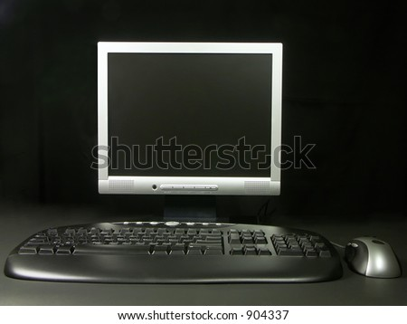 Operator's terminal with keyboard, mouse and LCD monitor over black background - stock photo