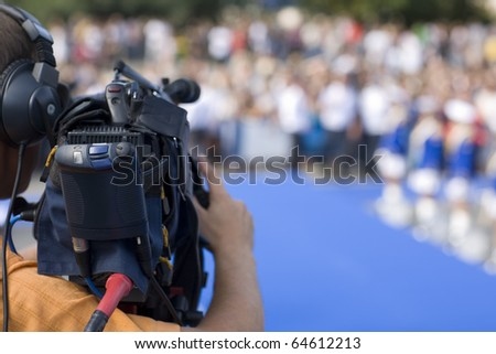 Operator television camera during a public event space. - stock photo