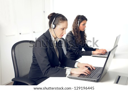 operators with headset working at computer - stock photo