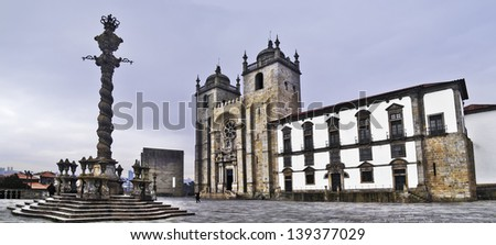 Oporto, December 2012. Oporto cathedral. XII - XIII centuries in romanesque style. Alteration in XVIII century on baroque style. Solomonic column outside. Oporto downtown is UNESCO World Heritage site - stock photo