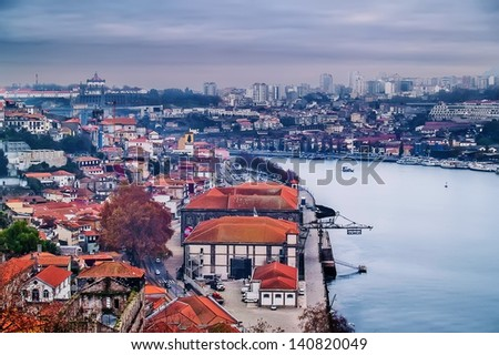 OPORTO, PORTUGAL - DECEMBER 3: View Douro river on December 3, 2012 in Oporto, Portugal. Oporto and Vila Nova de Gaia at both sides. - stock photo