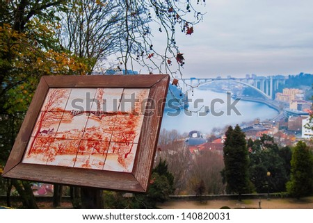 OPORTO, PORTUGAL - DECEMBER 3: View of Arrabida bridge from Crystal Palace Gardens on December 3, 2012 in Oporto, Portugal. Glazed tile representing the view. Architect Edgar Cardoso 1963, 615 meters. - stock photo