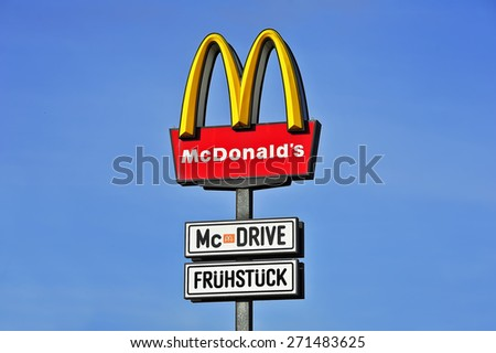 OPPENHEIM,GERMANY-MARCH 22:McDonald's Restaurants logo on MARCH 22,2015 in Oppenheim, Germany.The McDonald's Corporation is the world's largest chain of hamburger fast food restaurants. - stock photo