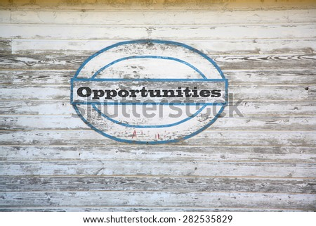 Opportunities Concept - Opportunities sign on shed side - stock photo