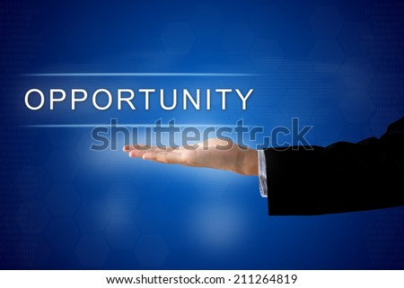 opportunity button with business hand on a touch screen interface - stock photo