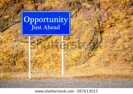 Opportunity, Just Ahead Green Road Sign at cliff - stock photo