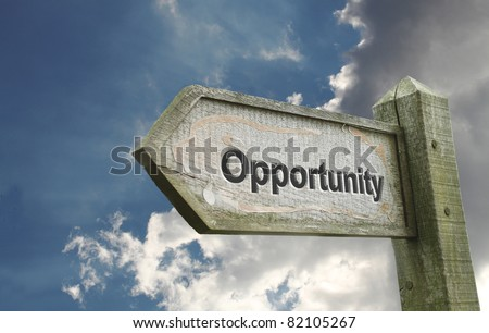 Opportunity Old Wooden Sign with Turbulent Background