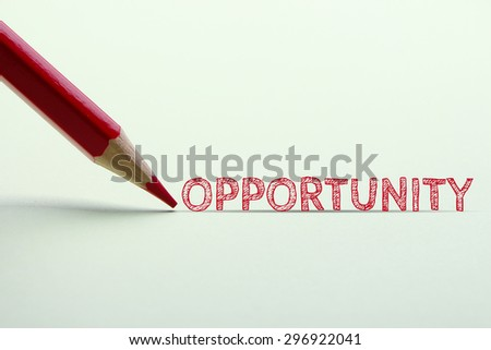 Opportunity word is standing on the paper with red pencil aside.