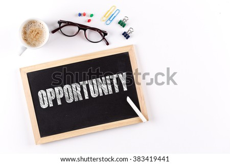 OPPORTUNITY word on Chalkboard with Coffee Cup, view from above - stock photo