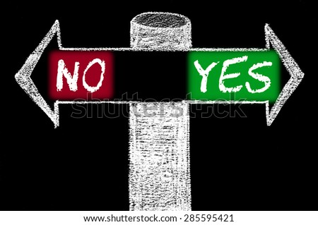 Opposite arrows with NO versus YES.Hand drawing with chalk on blackboard. Choice conceptual image - stock photo