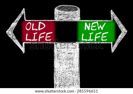 Opposite arrows with Old Life versus New Life.Hand drawing with chalk on blackboard. Choice conceptual image - stock photo