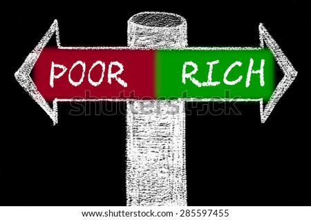Opposite arrows with Poor versus Rich.Hand drawing with chalk on blackboard. Choice conceptual image - stock photo