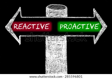 Opposite arrows with Reactive versus Proactive.Hand drawing with chalk on blackboard. Choice conceptual image - stock photo
