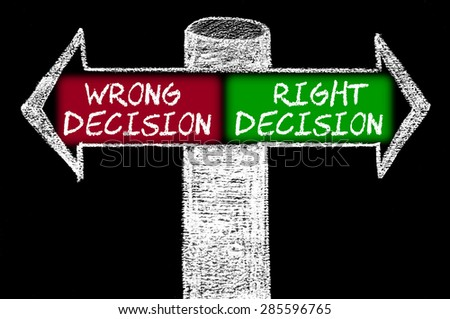 Opposite arrows with Wrong Decision versus Right Decision. Hand drawing with chalk on blackboard. Choice conceptual image - stock photo