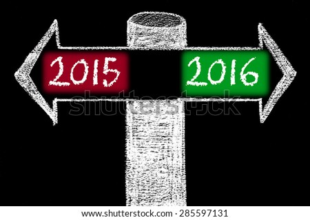 Opposite arrows with Year 2015 versus Year 2016.Hand drawing with chalk on blackboard. Choice conceptual image - stock photo