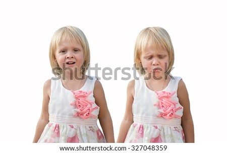 opposite emotions of children. blonde in white dresses, different emotions of twins, same but different, children twins  on a white background - stock photo