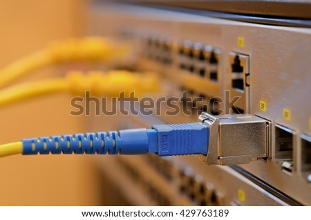 Optic fiber and SFP connected to switch. - stock photo