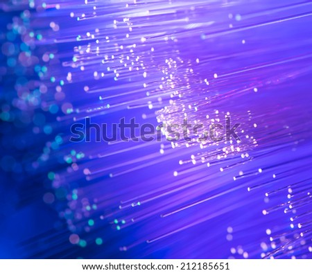 optical fibers flying from deep on technology background - stock photo