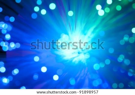 Optical fibers of fiber optic cable. Internet technology.Blue color - stock photo