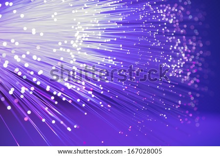 optical fibres dinamic flying from deep on technology background - stock photo