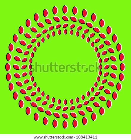 Optical illusion: rotation of circles made from dried fruits isolated on green background - stock photo