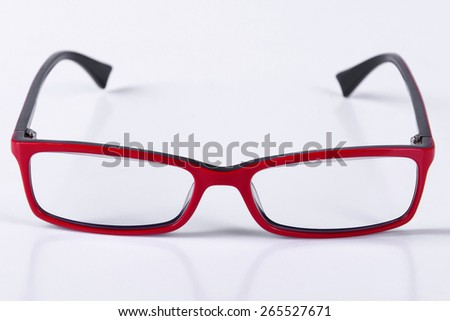 optical red glasses on a light gray background closeup
