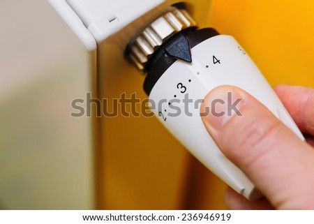 Optimal setting of the thermostat valve. Radiator adjustment to save energy - Radiator and thermostatic valve - Save energy and money concept  - stock photo