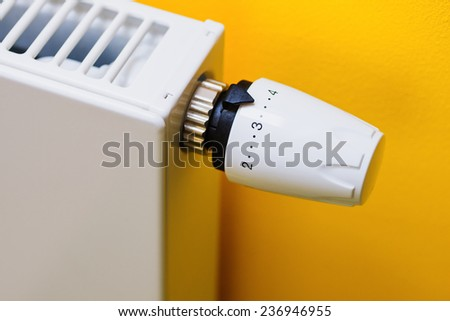 Optimal setting of the thermostat valve. Save energy and money concept - stock photo