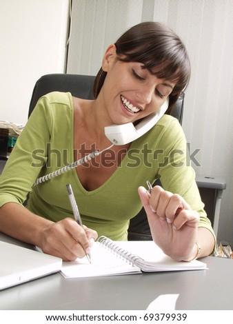 Optimist hispanic businesswoman working at office. - stock photo