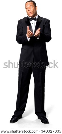 Optimistic African man with short black hair in evening outfit pointing using palm - Isolated