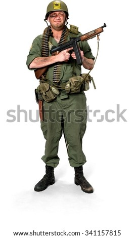 Optimistic Caucasian man in uniform holding machine gun - Isolated
