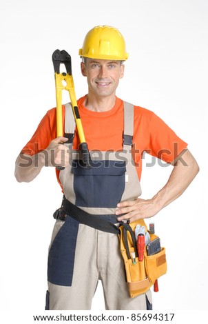 Optimistic construction worker holding a clamp and tools on white background.