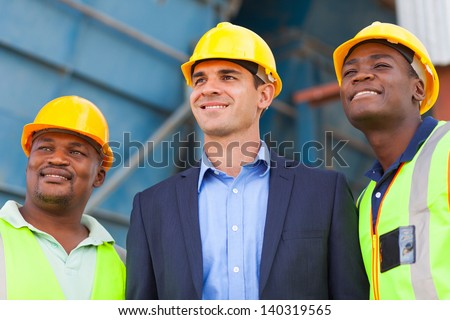 optimistic heavy industry manager and workers portrait - stock photo