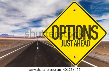 Options Just Ahead sign on desert road - stock photo