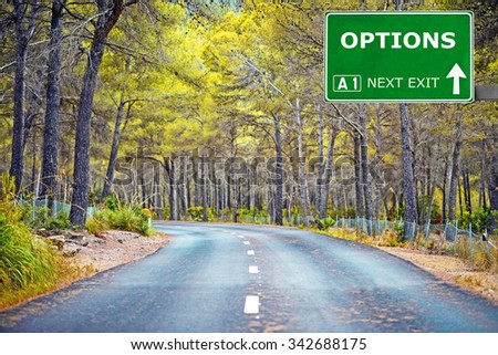 OPTIONS road sign against clear blue sky - stock photo