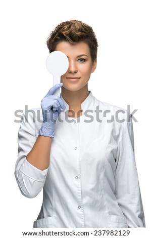 Optometry concept - pretty young woman having her eyes examined  isolated on white background - stock photo