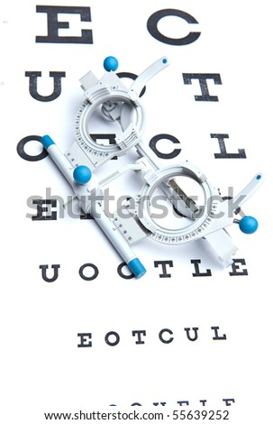 optometry concept - sight measuring spectacles & eye chart - stock photo