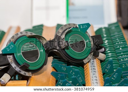 Optometry concept. test glasses phoropter with lens set for eye sight vision testing or examinations in clinic - stock photo